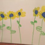 Detailed sunflowers by child